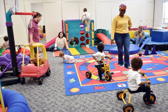 Children play and parents talk during the New Parent Support Program Playgroup at the Sagamihara Family Housing Area, Japan, Jan. 7.