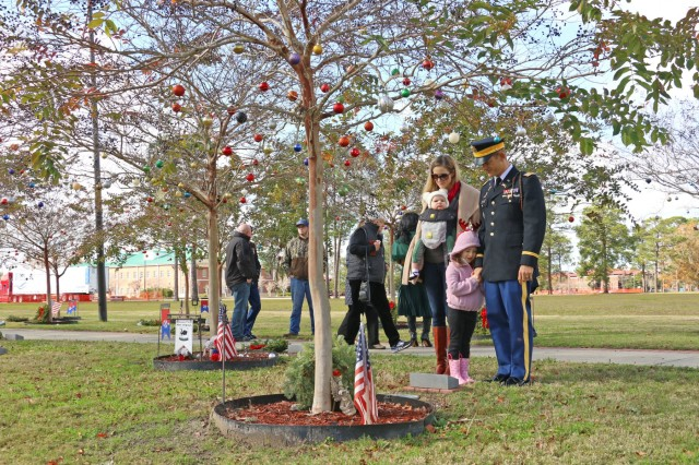 """Fort Stewart hosted Wreaths for Warriors Walk, December 14, in conjunction with the national """"Wreaths across America"""", to honor and show support to the families of the fallen Soldiers of Fort Stewart and Hunter Army Airfield (Photo by Staff Sgt. Todd Pouliot, 50th Public Affairs Detachment)"""