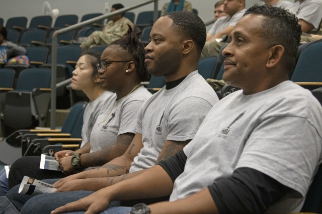 Graduates of the Home Builder Institute Transitioning Military Program attend their graduation ceremony at the Education Center on Fort Stewart, Ga., Dec. 13, 2019. HBI prepares transitioning Soldiers to attend training and receive job skills that will qualify them to fill positions available in the construction industry. (U.S. Army photo by Sgt. Zoe Garbarino)