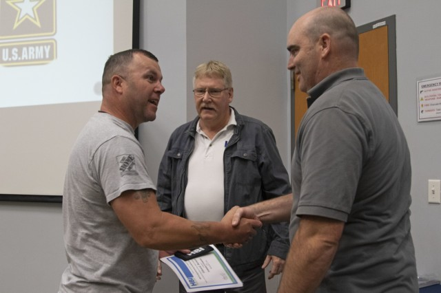 Sgt. 1st Class Edward Barnette, an armored crewman, receives his Home Builder Institute Transitioning Military Program graduation certificate at the Education Center on Fort Stewart, Ga., Dec. 13, 2019. HBI prepares transitioning Soldiers to attend training and receive job skills that will qualify the Soldiers to fill positions available in the construction industry. (U.S. Army photo by Sgt. Zoe Garbarino)