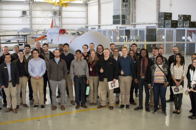 Twenty-one students from five Central Texas colleges took part in a Career Exploration Day Jan. 7, 2020 with the U.S. Army Operational Test Command, responsible for testing all new and modernized equipment. Here they stand with 11 OTC mentors in front of a Gray Eagle unmanned aircraft system.