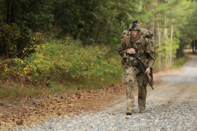 U.S. Army Spc. Alexander Vandermark conducts a road march during the 2019 HQDA Best Warrior Competition at Fort A.P. Hill, Virginia, Oct. 9, 2019. The Best Warrior Competition represents highly trained, disciplined and physically fit Soldiers from cohesive teams across the Army capable of winning on any battlefield. ( U.S. Army photo by Spc. Nathan Smith)