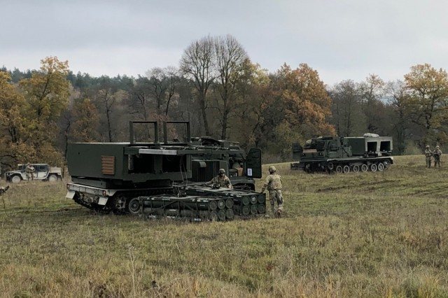 The 1-6 Field Artillery Battalion conducts dry fire missions with mock pods in the training fields at the U.S. Army Base in Grafenwoehr, Germany.