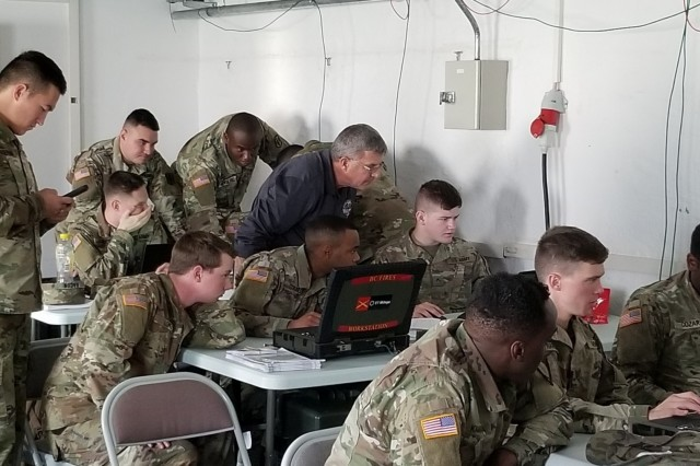 Lawrence Istre, OFT trainer, in the classroom providing over-the-shoulder training to the 1-6 FA Battalion Fire Direction Center at the U.S. Army Base in Grafenwoehr, Germany.