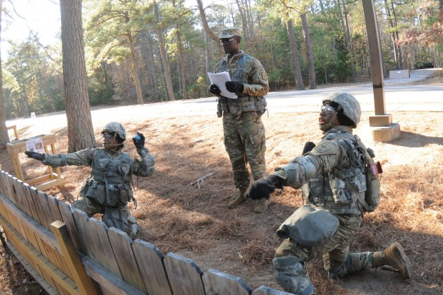 Sgt. Fredrick Omolo, Direct Support to the Exercise, evaluates the throws of two advanced individual training Soldiers at the grenade training facility located adjacent to Training Area 23 recently.