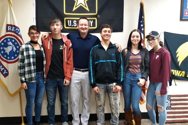 The five Wierzbicki siblings, Haley, Austin, Sequia, Sierra and Mason, take a photo with Staff Sgt. Lucas Jansson, station commander for Peru Army Recruiting Station Jan. 3. All five chose to enlist in the U.S. Army over the past two years. (Courtesy photo from Peru Army Recruiting Station)