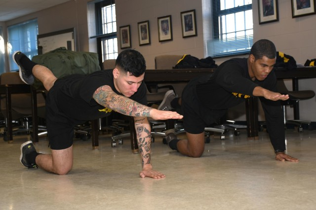 New York Army National Guard Soldiers assigned to the 10th Mountain Division Main Command Post - Operational Detachment, conduct a straight-leg deadlift exercise during an Army Combat Fitness Test training event in Syracuse, N.Y. Nov. 17, 2019.  Soldiers from the MCP-OD spent the day learning various exercise techniques, which can be done at home to help them prepare to take and pass the Army's new fitness test set to become the test of record in October.  U.S. Army National Guard photo by Staff Sgt. Warren W. Wright Jr.