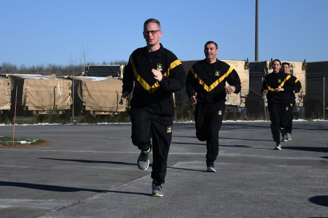 New York Army National Guard Soldiers assigned to the 10th Mountain Division Main Command Post - Operational Detachment, conduct sprint intervals in the unit's parking lot during an Army Combat Fitness Test training event in Syracuse, N.Y. Nov. 17, 2019.  During the training, Soldiers learned how to utilize what's available to them to better prepare for the new fitness test between drills at home. U.S. Army National Guard photo by Staff Sgt. Warren W. Wright Jr.