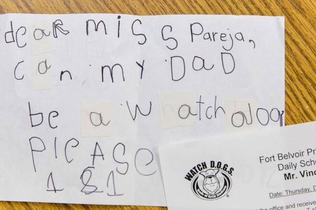 A first-grader's note to Fort Belvoir Primary School principal, Margo Pareja, lobbying for this dad to join the Watch D.O.G.S. Many dads and grandads have volunteered after demands from their young student.