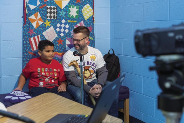 Shaun Chandler, and his son, Duncan, during morning announcements at Fort Belvoir Primary School. This was Chandler's first time as a Watch D.O.G. on campus.