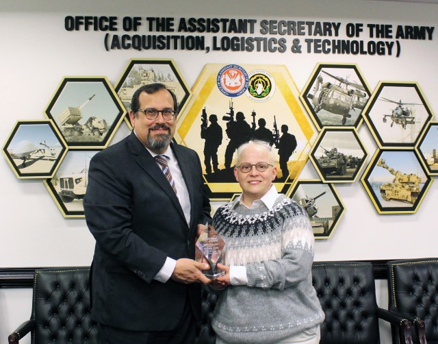 Dr. Perconti (left) presents Dr. VanMil (right) with Mentor of Year Award