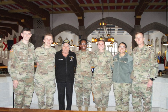 World War II veteran Vince Speranza, third from left, poses with cadets at the Mess Hall on Dec. 6 after singing the Alma Mater during lunch hour.