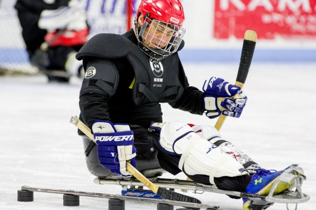 A 3rd Battalion, 85th Mountain Infantry Regiment, Warrior Transition Battalion, 10th Mountain Division Soldier practices his puck control by weaving it in and out of an obstacle. Soldiers from the battalion participated in sled hockey for morning physical training on Jan. 13th, 2020 at Watertown Municipal Arena, Watertown, N.Y.