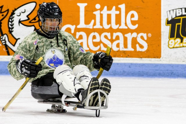 Maj. Gen. Brian J. Mennes, commander, 10th Mountain Division (LI) and Fort Drum, pushes himself around the ice on a sled for the first time. 3rd Battalion, 85th Mountain Infantry Regiment, Warrior Transition Battalion, 10th Mountain Division Soldiers participated in sled hockey for morning physical training on Jan. 13th, 2020 at Watertown Municipal Arena, Watertown, N.Y.