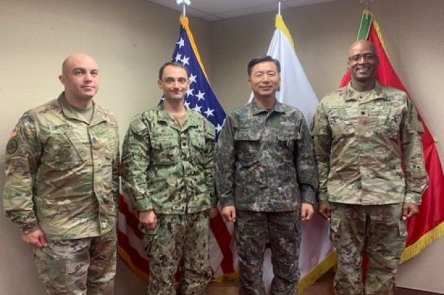 ROK director of logistics, Brig. Gen. Young-Sik Park (center right), poses for a photo with 837th leadership, Lt. Col. Andre L. Toussaint (right) and Sgt. Maj. Brandon Vargas (left), and the MSCO-K commander, Navy Cmdr. Matthew Muehlbauer.