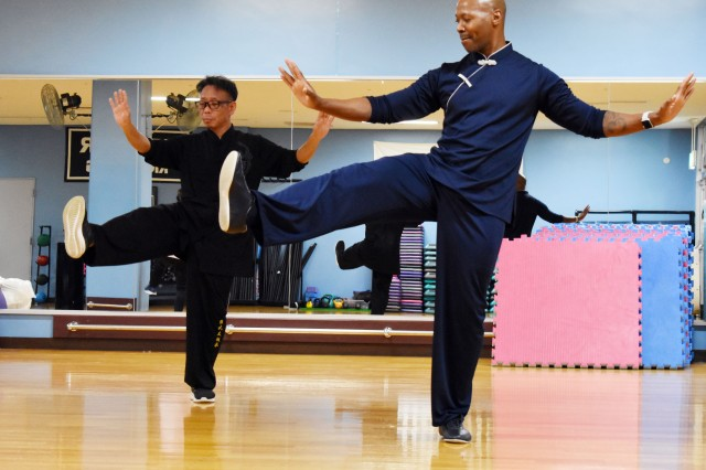 Michael Hammond, right, installation manager of U.S. Army Garrison Japan, and Kazuhisa Kato, a local national employee at Camp Zama and tai chi instructor, participate in a tai chi class at the Yano Fitness Center at Camp Zama, Japan, Jan. 9.