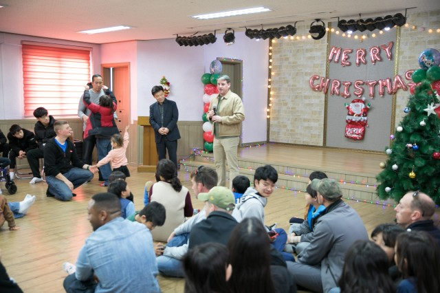 Soldiers and Military Families Spend Time at Children's Home in Korea During Holidays