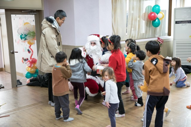 Army Captain Plays Santa at Children's Home in Korea during Holidays