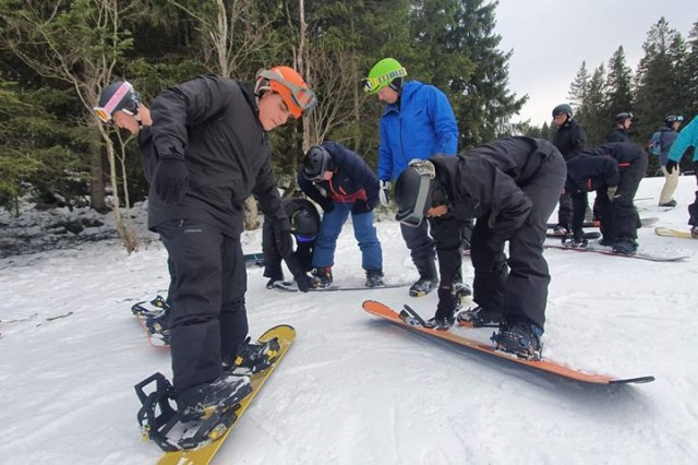 U.S. Army Soldiers assigned to the 1-4 Infantry Battalion snowboards during a Warrior Adventure Quest trip at the Edelweiss Lodge and Resort, Garmisch, Germany, Jan 7, 2019. The Warrior Adventure Quest program is a Department of the Army funded program designed to provide soldiers with a day of high activity through which they build camaraderie and cohesion through the ranks.