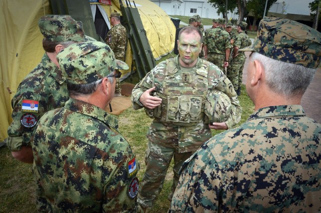 Lt. Gen. Ben Hodges, former commanding general, U.S. Army Europe, speaks to members of the Balkan Medical Task Force during a mass casualty medical training event as part of Exercise Saber Guardian 17, held at Mihail Kogalniceanu Air Base, Romania, July 16, 2017. Saber Guardian is a U.S.-led, multinational exercise with more than 25,000 military members from 22 allied and partner nations.