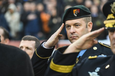 Medal of Honor recipient Master Sgt. Matthew O. Williams renders a salute during the playing of the National Anthem before the 2019 Army Navy Game in Philadelphia, Dec. 14, 2019.