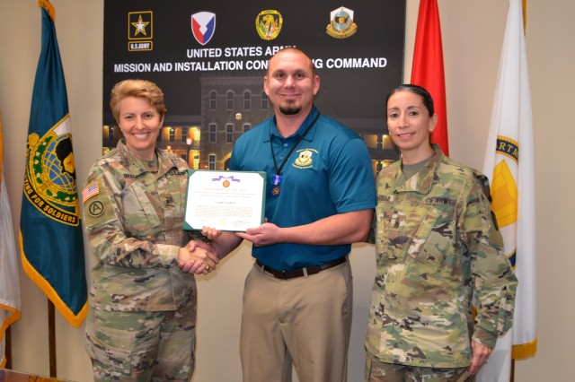 Brig. Gen. Christine Beeler, left, presents the Civilian Service Achievement Medal to Tyler Kurth recently as Command Sgt. Maj. Chantel Sena-Diaz looks on during a ceremony at Joint Base San Antonio-Fort Sam Houston, Texas.