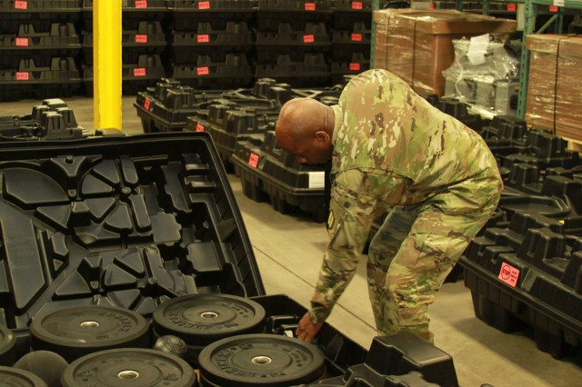 Sgt. 1st Class Ronald French, Michigan Army National Guard Regional Training Site Maintenance NCO, assists in completing the inventory of one lane of ACFT equipment.