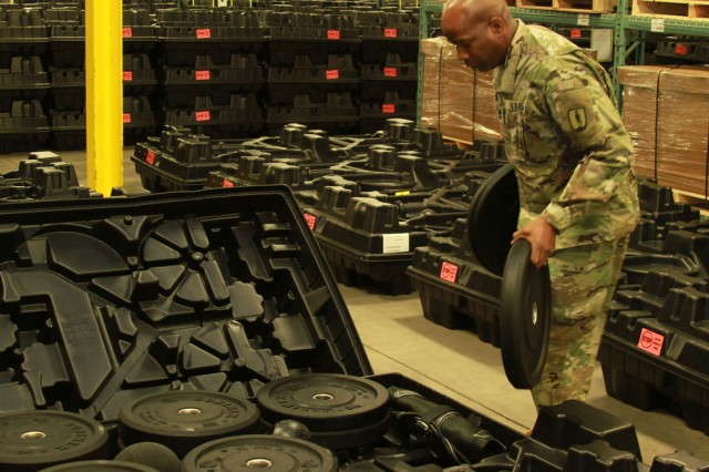 Sgt. 1st Class Ronald French, Michigan Army National Guard, counts bumper plates during the physical inventory of the Army Combat Fitness Test equipment.