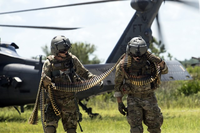 Special missions aviators from 41st Rescue Squadron (RQS) carry ammunition to an HH-60G Pave Hawk during a spin-up exercise at Patrick Air Force Base, Florida, Aug. 17, 2018. During the exercise, Airmen faced realistic scenarios and situations to prepare them for what they may encounter downrange.