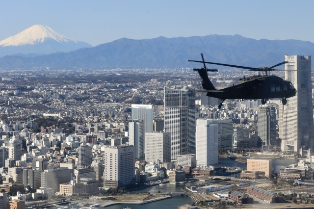 Soldiers with the U.S. Army Aviation Battalion Japan soar the skies in a UH-60 Black Hawk helicopter during a joint training exercise with members of the Japanese Ground Self-Defense Force to rehearse tactical flight operations at Camp Zama, Japan, Jan. 9, 2020.