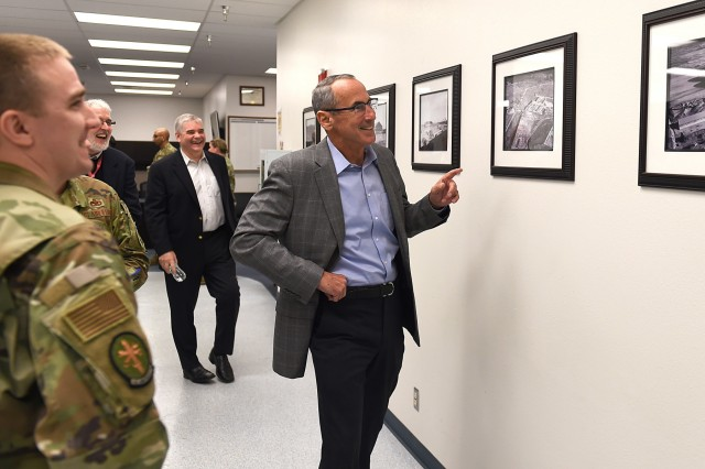 Retired Gen. Raymond Johns, National Commission on Military Aviation Safety committee member and former 62nd Airlift Wing commander, looks at the photos of when the precision equipment measurement lap building was being built many years ago on Joint Base Lewis-McChord during a visit Jan 7.