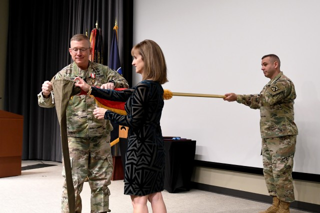 Lt. Gen. Michael Lundy, and his wife Paula Lundy, case his three star flag with the help of Combined Arms Center Command Sgt. Maj. Eric Dostie during Lundy's retirement ceremony Jan. 8, 2020 in DePuy Auditorium, Fort Leavenworth, Kan. Lundy was the CAC commanding general from May 2016 to Dec. 16, 2019. Photo by Tisha Swart-Entwistle, Combined Arms Center Public Affairs Office.