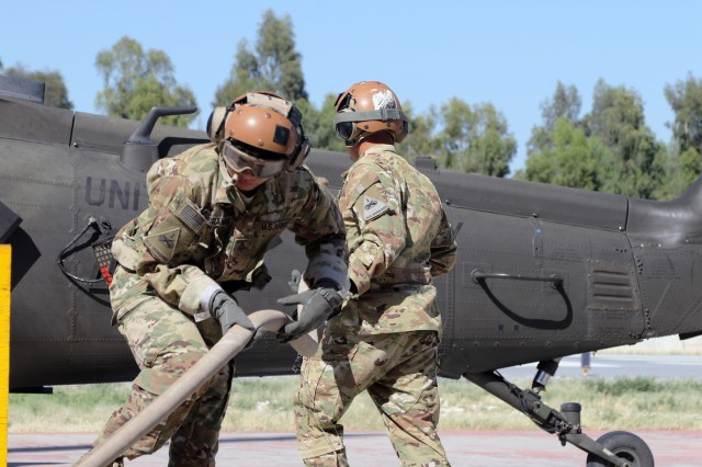 Soldiers assigned to Task Force Heavy Cav conduct refueling operations at Forward Arming and Refueling Point, Afghanistan to ensure aviation operations continue without delay.