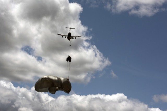 """Loads are dropped from a U.S. Air Force C-17 aircraft using the G-16 cargo parachute, which will allow units to drop at a lower altitude and reduce the number of parachutes required. """"Someone has to say, 'I have a need,' and be able to describe that need,"""" says Jette. (Photo by Jim Finney, Airborne and Special Operations Test Directorate, U.S. Army Operational Test Command)"""