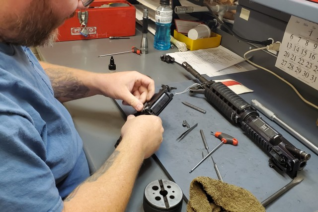 David Ryback, a worker at the Fleet Management Expansion at Fort Leonard Wood, reassembles an M4A1 lower receiver in support of the Tank-automotive and Armaments Command's Integrated Logistics Supply Center's Cost Avoidance Increased Readiness program. The program works to ensure that Soldiers have weapons readily available for training, aligning with the Army Materiel Command's focus of providing materiel readiness in preparation for future contingencies.