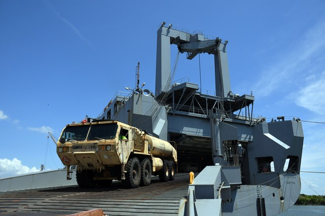 A wheeled vehicle assigned to 3rd Infantry Brigade Combat Team, 25th Infantry Division, rolls off USNS Brittin (T-AKR-305) vehicle cargo ship during port operations at Port of Port Arthur, Texas, Sept. 3, 2019. The operations were conducted as part of the unit's deployment to the Joint Readiness Training Center at Fort Polk, La.