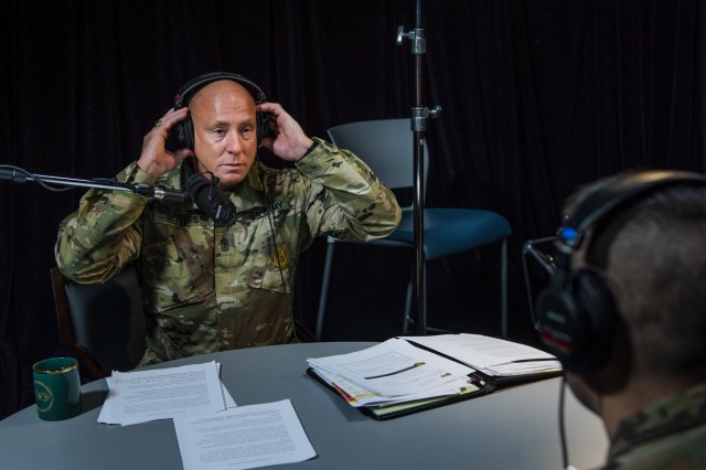 Sgt. Maj. Trevor Sellers, Army Reserve Headquarters inspector general sergeant major, puts on his headphones in studio to record an episode of the Army Reserve Leaders Corner podcast where he discussed the functions and needs of the Army Reserve IG on Dec. 19, 2019, at Fort Bragg, North Carolina. (U.S. Army Reserve photo by Master Sgt. Michel Sauret)