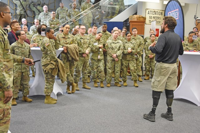 WIESBADEN, Germany -- Retired Master Sgt. Chris Corbin, wounded warrior, talks to a group of Soldiers and civilians Jan. 13, 2020, at the Mission Command Center on Clay Kaserne. Corbin and five other wounded warriors, including a Medal of Honor recipient, shared their stories of hope after life-changing injuries.