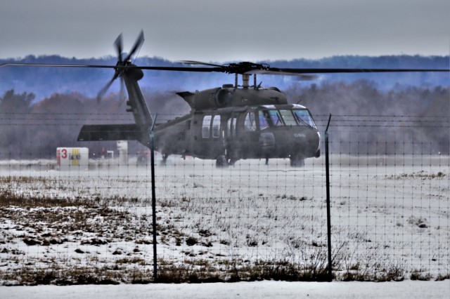 An aircrew flies a UH-60 Blackhawk helicopter at the Sparta-Fort McCoy Airport during training operations Dec. 16, 2019, at Fort McCoy, Wis. According to the Army fact sheet for the Blackhawk, its mission is to provide air assault, general support, aeromedical evacuation, command and control, and special operations support to combat, stability, and support operations. The UH-60 also is the Army's utility tactical transport helicopter. The versatile helicopter has enhanced the overall mobility of the Army due to dramatic improvements in troop capacity and cargo lift capability over the years as well.