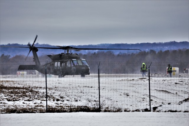 An aircrew operates a UH-60 Blackhawk helicopter at the Sparta-Fort McCoy Airport during training operations Dec. 16, 2019, at Fort McCoy, Wis. According to the Army fact sheet for the Blackhawk, its mission is to provide air assault, general support, aeromedical evacuation, command and control, and special operations support to combat, stability, and support operations. The UH-60 also is the Army's utility tactical transport helicopter. The versatile helicopter has enhanced the overall mobility of the Army due to dramatic improvements in troop capacity and cargo lift capability over the years as well.