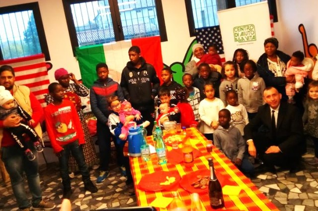 Soldiers from U.S. Army Dental Health Activity - Italy were part of a group of military and civilian volunteers from Caserma Ederle in Vicenza, Italy who lifted the spirits of children and immigrant families in need during the Christmas holidays with a visit to SOS Villagio del Bambini.