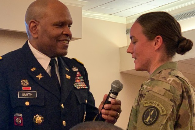Lt. Gen. Leslie Smith, inspector general of the Army, talks to 1st Lt. Kelly Jeffries, executive officer of the 529th Regimental Support Company, during a Martin Luther King Jr. birthday commemoration at Joint Base Myer-Henderson Hall Jan. 15, 2020. Smith discussed how Soldiers and community members can honor the legacy of the late Martin Luther King Jr.
