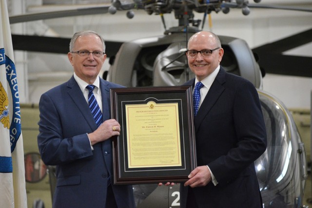 Patrick Mason accepts the Program Executive Office for Aviation charter from Dr. Bruce Jette, Assistant Secretary of the Army for Acquisition, Logistics and Technology, during a Jan. 14 change of charter ceremony. Photo by Denise DeMonia
