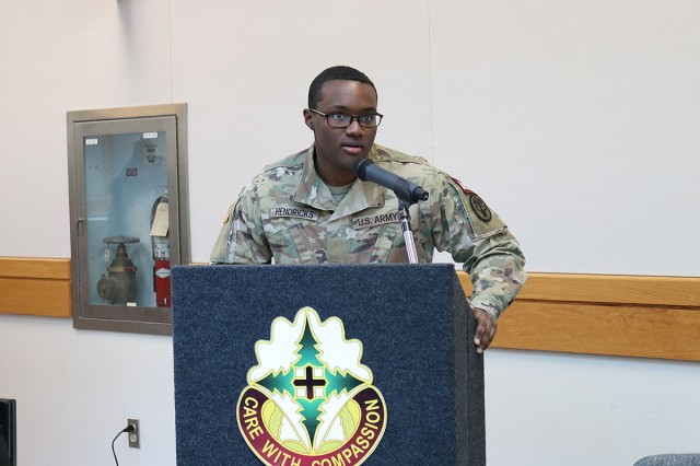 "Pvt. Rondale Hendricks, an operating room specialist student, recites his winning poem, ""One for the Memories"" at the Martin Luther King, Jr. Day observance in the Medical Mall at Madigan Army Medical Center on Joint Base Lewis-McChord, Wash., on Jan. 16."