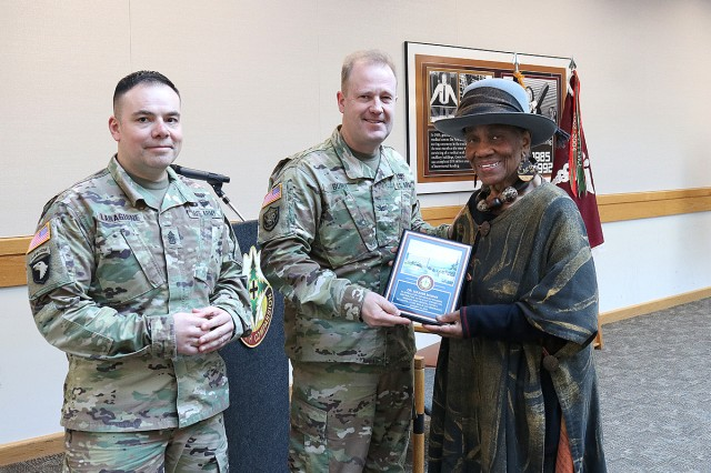 Madigan Army Medical Center Commander Col. Thomas Bundt and Command Sgt. Maj. Victor Laragione gives a plaque of appreciation to Dr. Maxine Mimms, the distinguished guest speaker, for her participation in Madigan's Martin Luther King, Jr. Day observance on Jan. 16.