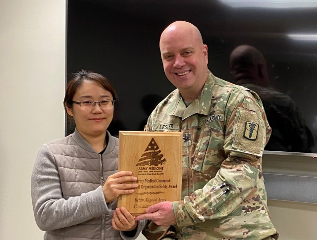 Ms. Un Chong Cho receives the award on behalf of BDAACH safety team
