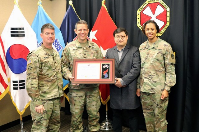 Maj. Gen. Patrick Donahoe, left, deputy commanding general for operations of the Eighth Army, presents the battalion-level Fiscal Year 2019 Eighth Army Exceptional Operational Safety Award to the U.S. Army Medical Materiel Center-Korea. Accepting the award are, from center-left, Commander Lt. Col. Marc R. Welde, Safety and Occupational Health Specialist Chaehun Choe and Sgt. Maj. Danyell E. Walters.