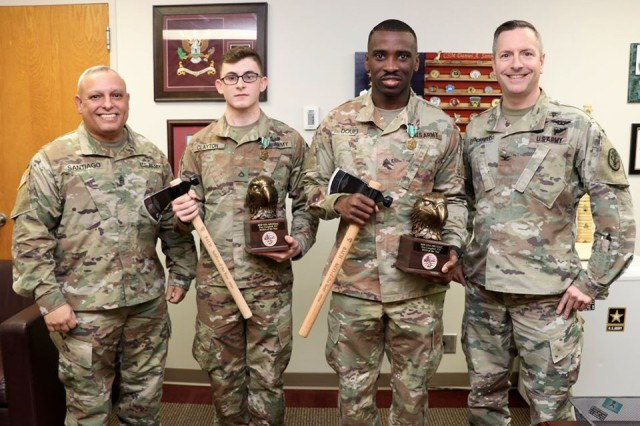 Blanchfield Army Community Hospital named Sgt. Mondeka Douei and Pfc. Austin Clayton NCO and Soldier of the Year after a week-long competition, Jan. 10-16 on Fort Campbell. Hospital Command Team, Col. Patrick T. Birchfield and Command Sgt. Maj. Daniel Santiago presented the Soldiers with the Army Commendation Medal and other mementos for their achievement.