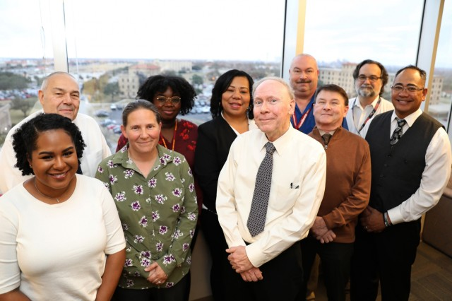 The MEDCOM Medical Assistance Group (MMAG) was redesignated as the Army Medical Readiness Assistance Program (AMRAP).  The Ombudsman Program and Wounded Soldier and Family Hotline (WSFH) will be managed by the AMRAP for more streamline assistance to beneficiaries.  The main office is located at Fort Sam Houston, Texas.  Front Row staff (L-R): Pamela Shelton (Wounded Soldier and Family Hotline Team Member), Amanda Fernandez (Wounded Soldier and Family Hotline Team Member), Timothy Koenig (AMRAP Program Manager), John Dingman (Action Officer), Lemailoa Tuiasosopo (IT Systems/Data Manager). Back Row staff (L-R): Angelo Armondo (Wounded Soldier and Family Hotline Contract Program Manager), Briana Gillmore (Wounded Soldier and Family Hotline Team Member), Mitzuli Fields (Operations Supervisor), Bobby Slater (Action Officer), Roland Neault (Health System Specialist). The main office is located at Fort Sam Houston, Texas.