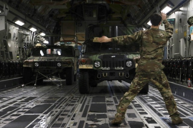 U.S. Air Force personnel load 1st Brigade Combat Team, 82nd Airborne Division equipment bound for the U.S. Central Command area of operations from Fort Bragg, N.C., on Jan. 4, 2020.